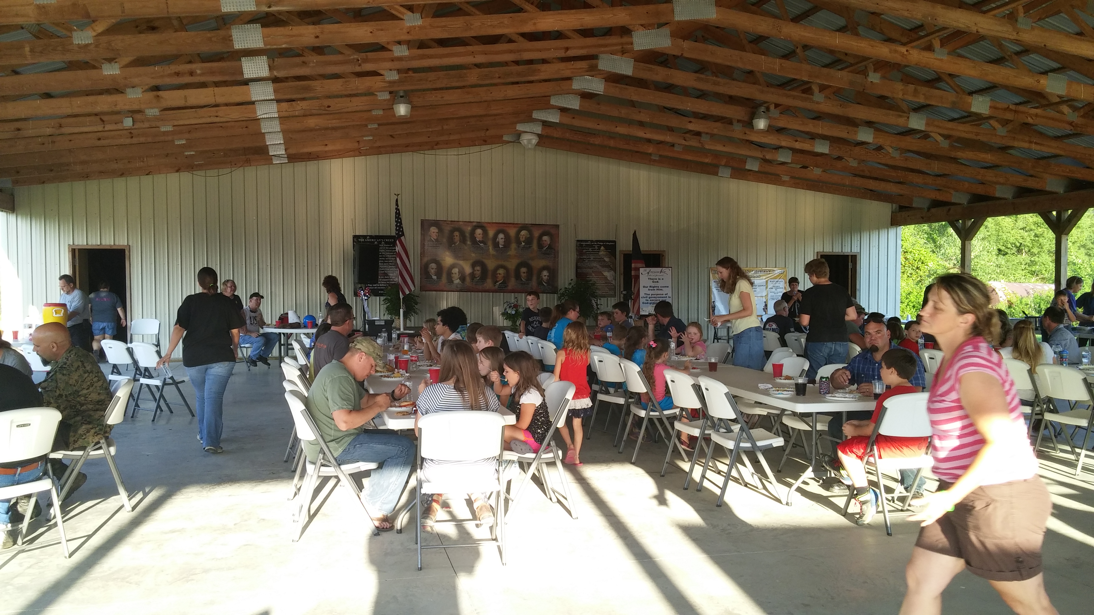 Campers and their families enjoy fellowship at the picnic